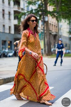 Viviana Volpicella wears a red bandana with a printed maxi in Milan