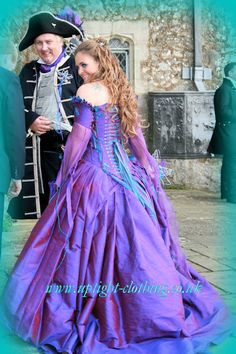 PURPLE& TURQUOISE DRAGONFLY FAIRYTALECORSET WEDDING DRESS IN REALD BRIDE CHERIE BY Uptight Clothing:STUNNING FAIRYTALE CORSET WEDDING DRESS GREAT FOR ALTERNATIVE, CASTLE, PAGAN, HANDFASTING FANTASTY STYLE WEDDINGS. Fantastic Period Inspired Fairytale Corseted Gowns, as well as Underwear