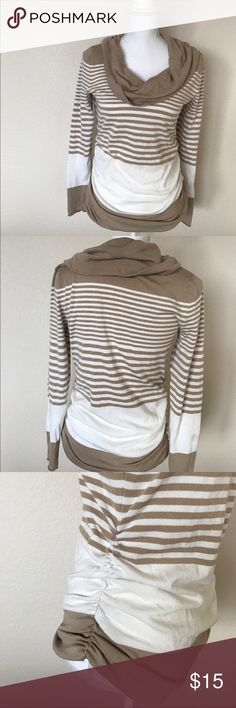 [ c o w l n e c k . s w e a t e r ] Cozy tan and cream striped cowl neck sweater! Cute rouching on either side makes it super cute on! Size small but could fit medium! Slight stain on arm barely noticeable! Shown in pic. Sweaters Cowl & Turtlenecks