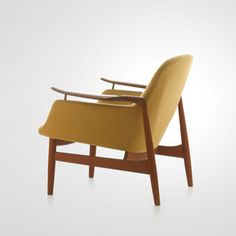 Finn Juhl: 53 Chair.  Made of teak and wool and really beautiful from any angle.