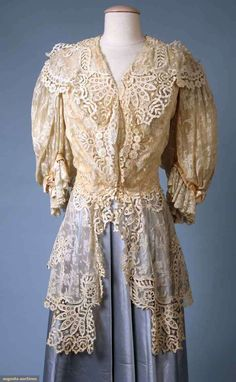 CREAM VALENCEINNES LACE JACKET, c.1905 -  Val. Lace, puffed & flounced elbow length sleeves, bodice fitted to waist w/ long peplum, embroidered eyelet edging & insertions on peplum, collar & jacket, blush lining