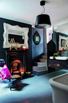 black walls, big white baroque mirror! cool bathroom!