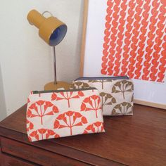 Screen printed 'Hydrangea' wash bag in sage green and tangerine 🌿