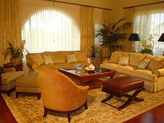 Living room spells c-o-m-f-o-r-t. Rug blends with furnishings and drapery colors.,