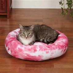 Cozy Kitty Bed is a must have for cats. In two distinctive styles: Classic and cozy berber Soft cheetah print plush that's purr-fectly sassy Made of easy-care, machine washable polyester Each style is stain-resistant and features a soft polyfill design with a non-skid nylon bottom. Material: 100% Polyester