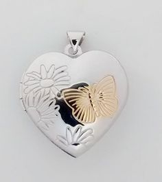 Opening silver butterfly locket £32