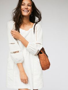 Peasant Girl Mini Dress | Femme peasant-style dress featuring an off-the-shoulder silhouette with volume sleeves. Crochet accents throughout.    * Outer pocket details * Lined