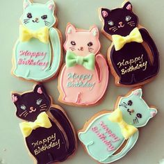 All bow ties should be made of icing. (Kitty cat sugar cookies via Commune -gallery/cafe/shop)