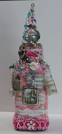 A to Zinnia alice in wonderland altered bottle