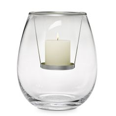 """Unique design uses a metal candle hanger to suspend a pillar candle, sold separately, in a vessel of hand-blown glass. Add your own seasonal decorations to create a custom display. 10½""""h, 9""""dia."""