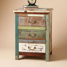 Paintbox Side Table A simply charming chest, handcrafted in reclaimed wood with patches of vintage paint intact. Three roomy drawers with brass handles.