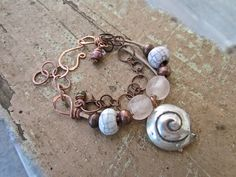 Handmade Bracelets  Multi-Strand Leather and Copper  925 Silver Nautilus Charm Custom order.   SOLD
