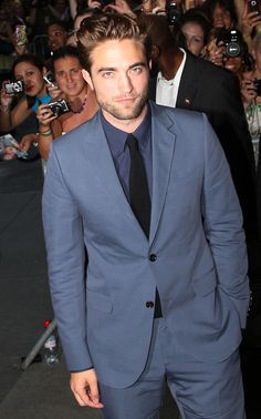 Don't care what anyone says he is so my Christian Grey...that boy knows how to wear a suit