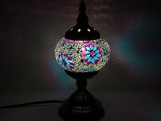 This beautiful Turkish / Moroccan mosaic table lamp with a bronzed finish makes a fine choice for offering you a colorful and chromatic lighting option. With a fine little LED bulb inside that lights up the whole room and offers spectacular levels of illumination, this is the ideal starting point for those who need something with more artistry and detail to it. Give yourself the gift of something special that, without doubt, will offer a more charming and creative source of lighting. With…