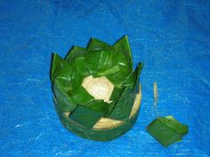 Loy Kratong 2: Next is to put the strips of leaf around the side of the base to cover it. You also need a circular piece of leaf to cover what is left exposed of the base.