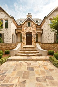 French Country style home in Atlanta, GA.  With a mixture of stone, brick, stucco and cedar, all the elements combine to scale down this large 16,000 sq. ft. home.