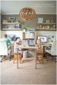 In home office fit for the whole family. His and hers desks and childrens table.