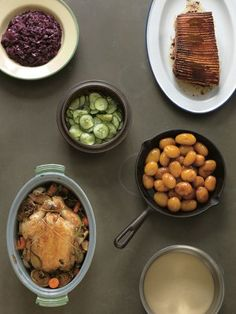Clockwise from top left: Sweet-and-Sour Braised Red Cabbage; Roast Pork and Crackling; Quick Pickled Cucumbers; Danish Sugar-browned Potatoes; Basic Cream Sauce; Pot-Roasted Chicken from The Nordic Cookbook by Magnus Nilsson