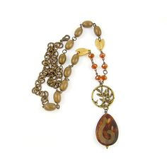 Earthy Necklace Agate Wood Rust Brown Tan Leaf Pendant Brass Circle... ($32) ❤ liked on Polyvore featuring jewelry, necklaces, wooden bead necklace, teardrop pendant necklace, leaf pendant necklace, wood bead necklaces and wood necklace