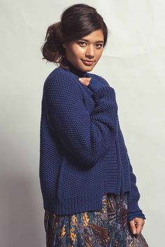The FLEET CARDIGAN by Jennifer Dassau is worked back and forth, top down. The sleeves are worked in the round. Find the pattern in the Fall 2017 issue of Knitscene.