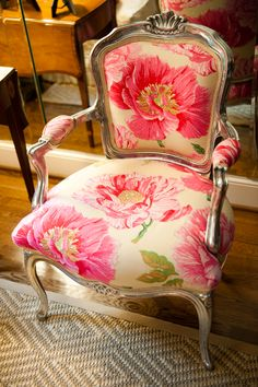 Lovely vintage chair recovered in a large patterned fabric. The fabric suits this chair beautifully.  So elegantly off settled by the mirrored wall to giving it more depth. JH