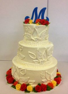 Intricate tone on tone piping with bold fall colored flowers