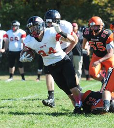 North Quincy's Aidan Brown, carries the football during their game on Saturday, Oct. 10, 2015 as Middleboro High School defeats North Quincy High School 41-7. (Marc Vasconcellos/The Enterprise)
