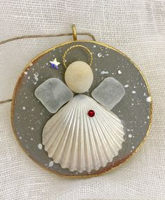 A personal favorite from my Etsy shop https://www.etsy.com/listing/557587134/beachcomber-angel
