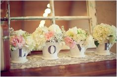 Would be cute on Gift Table  Simple decor - Hydrangea, roses & baby's breath in decorative stamped mugs, rustic windows