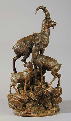 great carved wood ibex family on a rock, swiss 1900