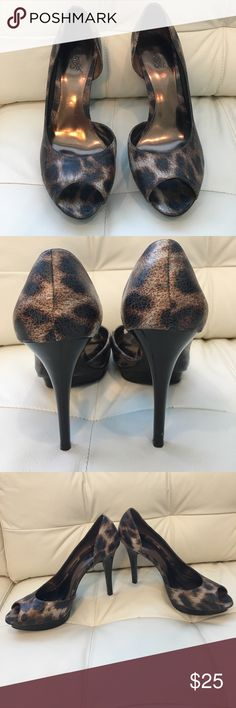 Carlos leopard peep toe pumps In excellent condition Carlos by Carlos Santana leopard print peep toe pumps. Pairs perfectly with a little red dress or black skinny jeans. Carlos Santana Shoes Heels