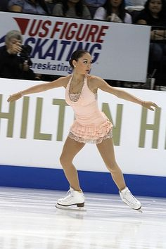 Another pinner said: Elene Gedevanishvili at 2011 Skate America wearing a halter dress with tiered skirt. You could make something similar using Jalie pattern 3028 - View B (http://www.jalie.com/jalie3028-twist-halter-dress-sewing-pattern.html)