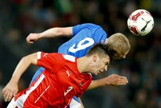 Austria's Aleksandar Dragovic (bottom) and Iceland's Kolbeinn Sigthorsson fight for the ball during their international friendly soccer match in the Austrian city of Innsbruck May 30, 2014. REUTERS/Dominic Ebenbichler