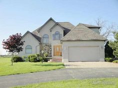 $200,000 Beautiful home w/spacious kitchen w/granite counters & wood floors. Eating area w/door wall to deck. Great room w/vaulted ceilings & lovely gas fireplace. Master suite w/door wall to 2nd deck, full bath w/jetted tub & WIC. Finshed lower level walk out w/lots of storage room. Well bulit w/extra insulation, 40 year shingles, black top driveway, paver patio & walkways. 12 x 18 shed. Home warranty & all appliances included.