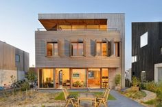 Beautiful House Made From Teak Wood With Tilt Turn Windows And Sliding Door beautiful house with teak wood material building modern interior