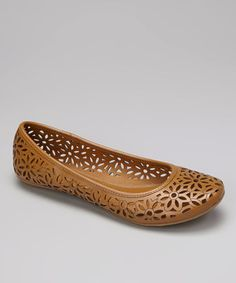 Lace-style cutouts and tidy stitches make for a flat that's prim and pretty.