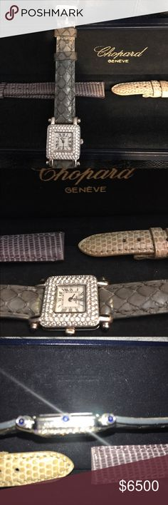 "Chopard Classique Femme Diamond Watch + 2 straps SALE!!!!AUTHENTIC ladies 18kt white gold 23mm Chopard Classique Femme quartz Diamond bezel watch with cabochon accents at lugs and crown, flat dial, Roman numerals, baton dauphine hands, sapphire crystal,grey , beige, and violet embossed leather strap with  18kt gold Chopard tang buckle closure in original box! Fits wrists 7"" and smaller Comes with appraisal for $18,500!(the last pic is from another source same exact watch with different band…"