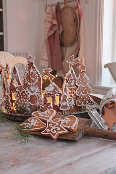 Gingerbread cookies, arranged in a semi-circle as a town, by Vibeke Saether Svenningsen of Vibeke Design in Norway Gingerbread Christmas Decor, Gingerbread Village, Christmas Deserts, Gingerbread Decorations, Christmas Decorations For The Home, Christmas Ornaments To Make, Christmas Makes, Christmas Time, Christmas Holidays