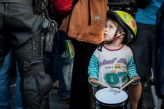 Little activist watching an enormous police.