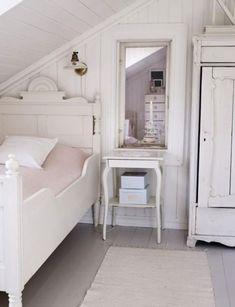 Such a pretty attic bedroom.