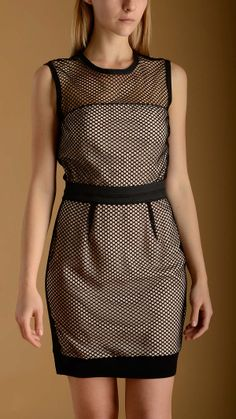Mesh bicoloured sheath dress in pink and black characterized by an elasticized waistband, ribbed cotton detail at the bottom, back zip fastening, sleeveless, round neck, knee lenght.