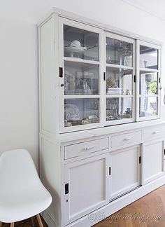 Pretty milk paint hutch makeover in white via @Songbird Blog
