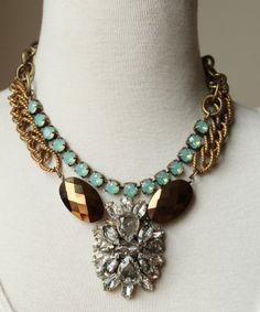 Vintage brass textured chain, crystal pendant, bronze stones, and opal swarovski crystals.