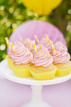 The cupcakes at this sweet summertime lemonade stand party are gorgeous!   See more party ideas and share yours at CatchMyParty.com  #catchmyparty #partyideas #lemonadeparty #lemonadestand #lemon #summerparty #girlbirthdayparty #lemonadecupcakes