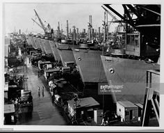 Nine liberty cargo ships docked at the outfitting yard of the California Shipbuilding Corporation are readied for delivery to the U.S. Maritime Commision, December 1943. | Location: California Shipbuilding Corporation, Los Angeles, California, USA.
