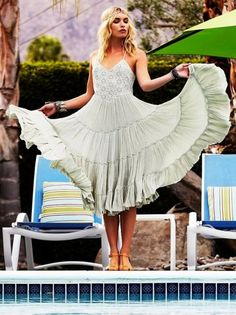 Love the flow of this dress, but I would brighten up the color.