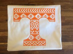 A personal favorite from my Etsy shop https://www.etsy.com/listing/565399537/tennessee-vols-aztec-power-t-shirt