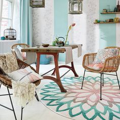 A sculptured floral design in turquoise colour tones which will make a beautiful design statement to any room.