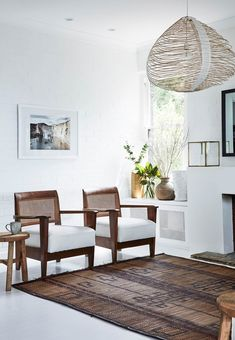 """An all-white palette allows the furniture to shine in this living room. """"We used Dulux 'Natural White' – my go-to colour – on the walls and ceiling, and Feast Watson 'White' floor paint. Modern Rustic Furniture, Modern Rustic Interiors, Colorful Interiors, Outdoor Furniture Sets, Dulux Natural White, Plantation Style Homes, Ikea, Tadelakt, Houses"""