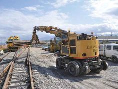 Discover our Railroad Loader An unrivalled explosion of power and control for works on rails and road. SOLYTEK your Supplier of Railway Infrastructure Equipment Turbo Intercooler, Drilling Tools, Work Train, Hydraulic Cylinder, Common Rail, Diesel Engine, Heavy Equipment, Crane, Trucks